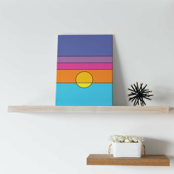 vertical stretched canvas art print with a colorful minimalist sunset design on a shelf