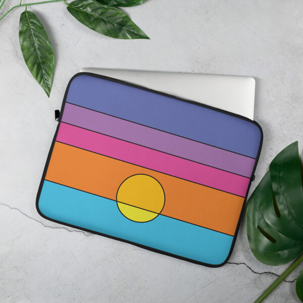 laptop sleeve with a colorful minimalist sunset design sitting on a table