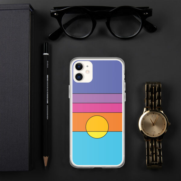 iphone case with a colorful minimalist sunset design sitting on a desk with a watch