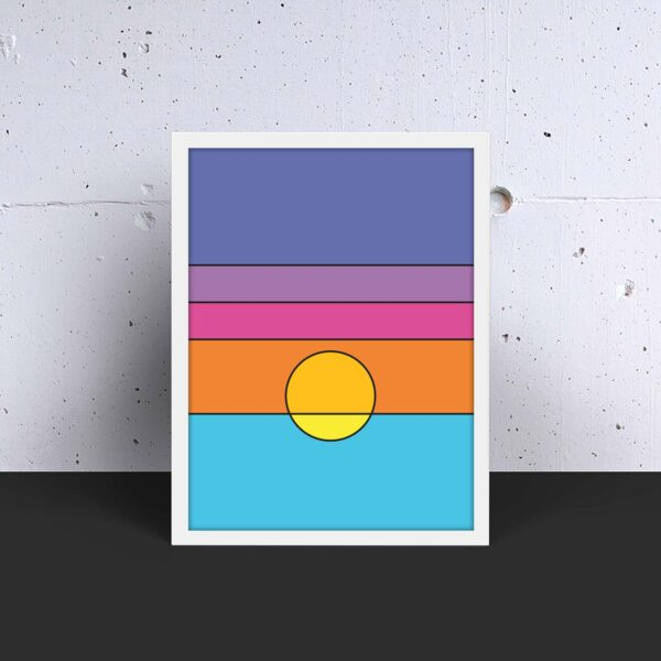 vertical art print with a colorful minimalist sunset design in a white frame on a table