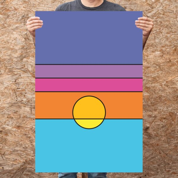 person holding a large vertical art print with a colorful minimalist sunset design