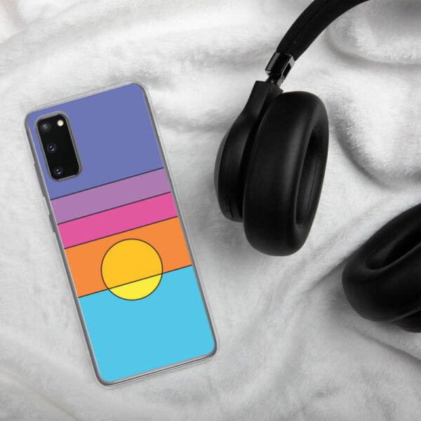 samsung phone case with a colorful minimalist sunset design sitting next to headphones