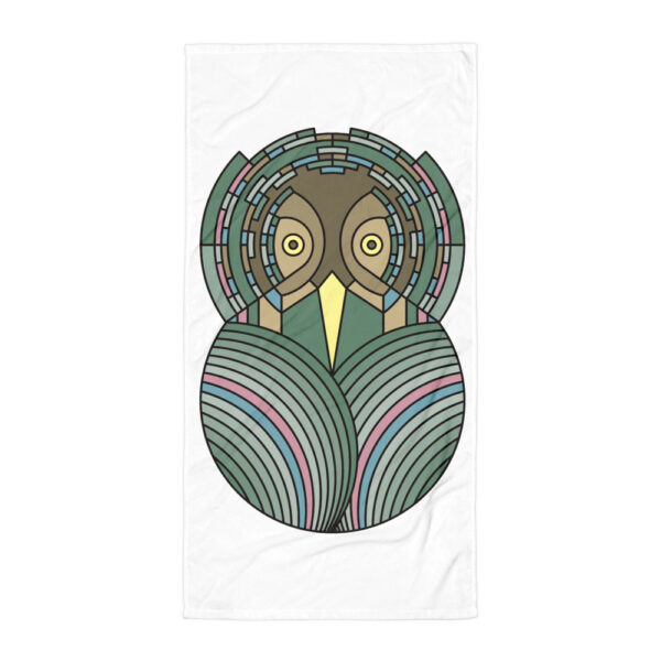 white beach towel with a colorful green and brown owl design