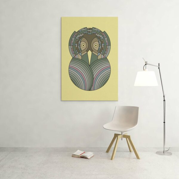 large vertical stretched canvas art print with a colorful green and brown owl design on yellow background hanging on a wall