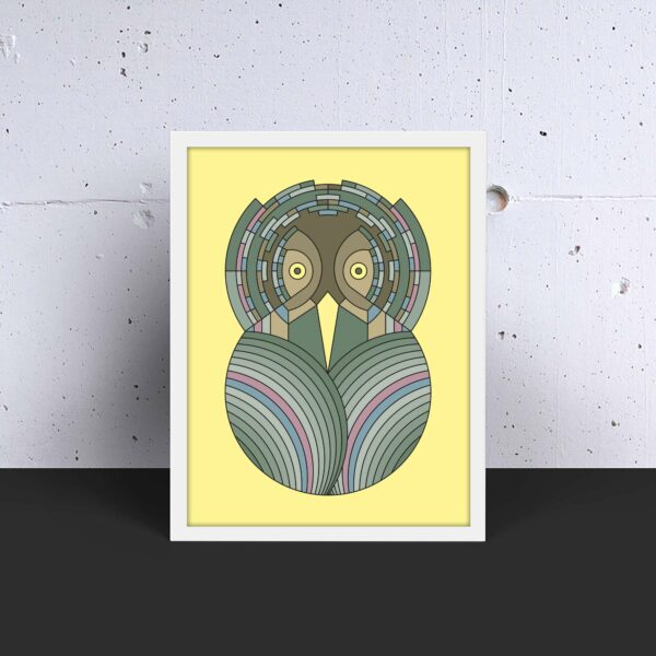 vertical art print with a colorful green and brown owl design on a yellow background in a white frame on a table