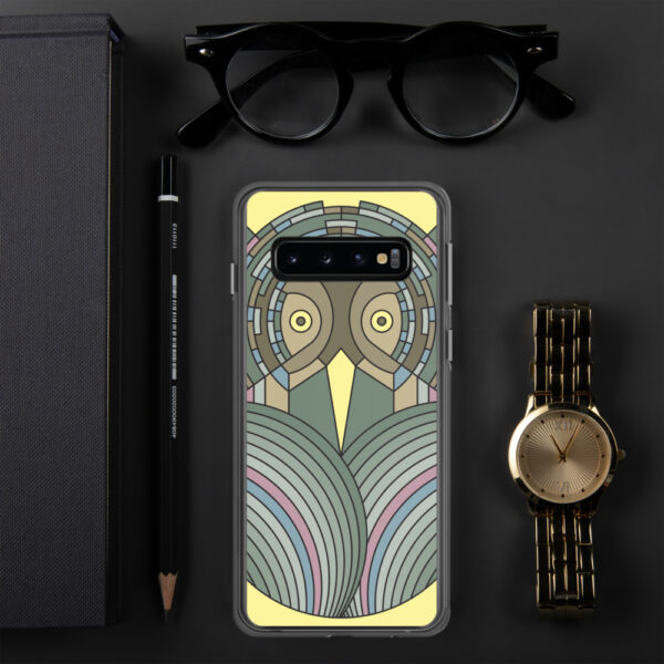 samsung phone case with a colorful green and brown owl design sitting next to a watch