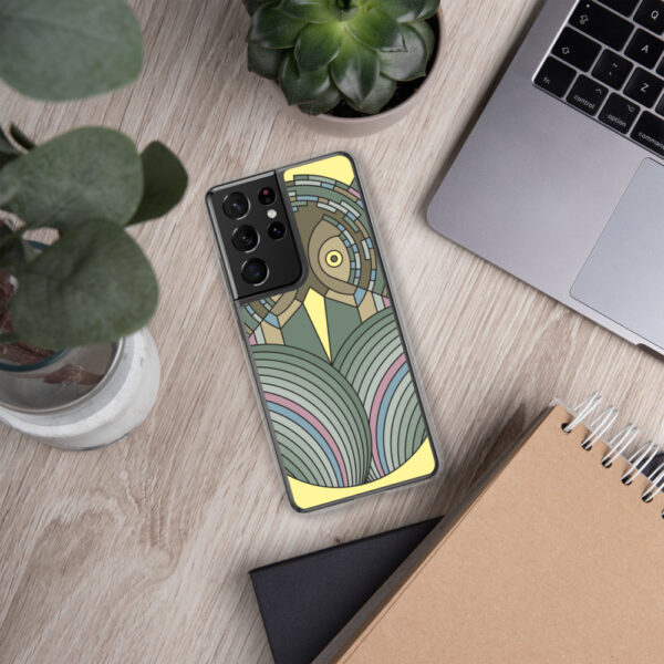 samsung phone case with a colorful green and brown owl design sitting next to a laptop