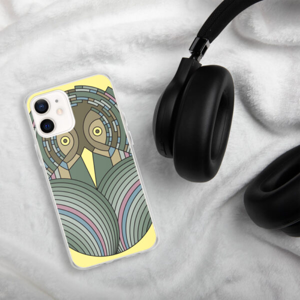 iphone case with a colorful green and brown owl design sitting next to headphones
