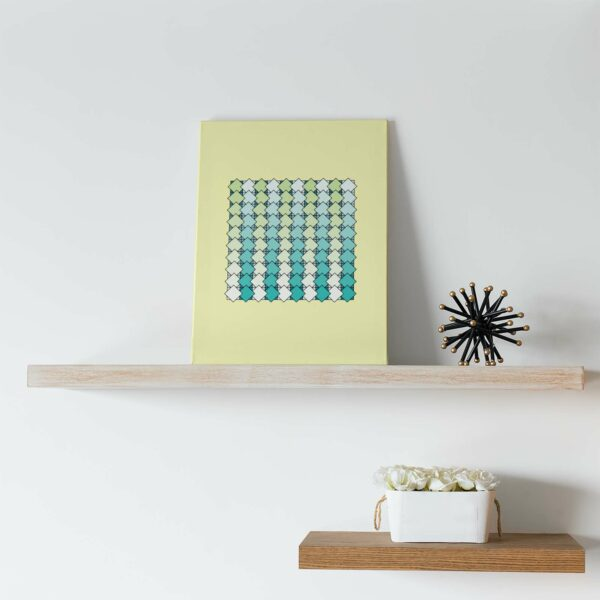 stretched canvas art print of a blue and green tile pattern on a yellow background sitting on a shelf