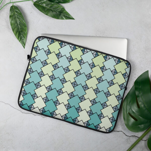 laptop sleeve with a blue and green tile pattern sitting on a table