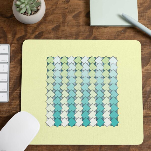 mouse pad with a blue and green tile pattern on a yellow background on a desk with a computer mouse