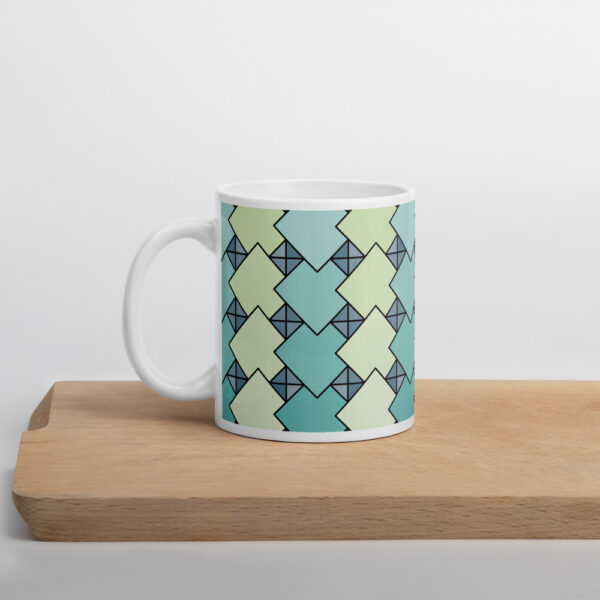 11 ounce coffee mug with a blue and green tile pattern on a shelf