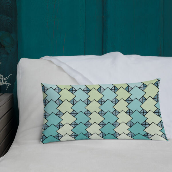 20 inch wide by 12 inch tall pillow with a blue and green tile pattern on a bed
