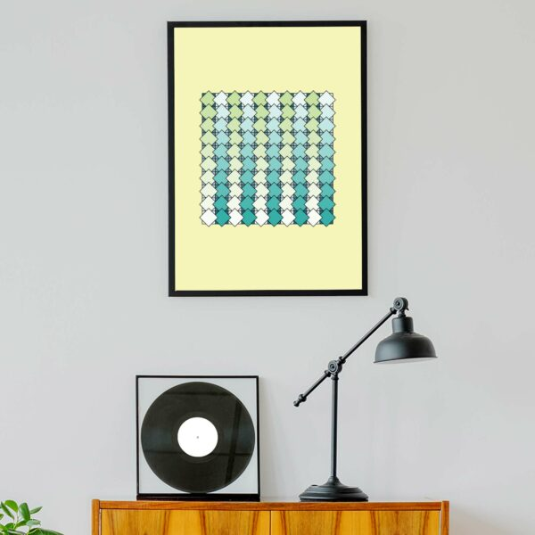 vertical art print with a blue and green tile pattern on a yellow background in a black frame hanging on a wall above a turntable