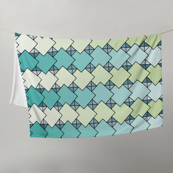blanket with a blue and green tile pattern hanging on a clothes line