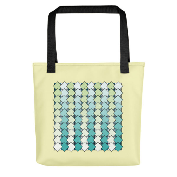 tote bag with a blue and green tile pattern on a yellow background and black handles