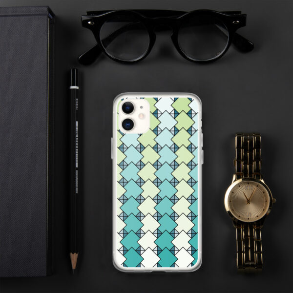 iphone case with a blue and green square tile pattern sitting on a table next to a watch