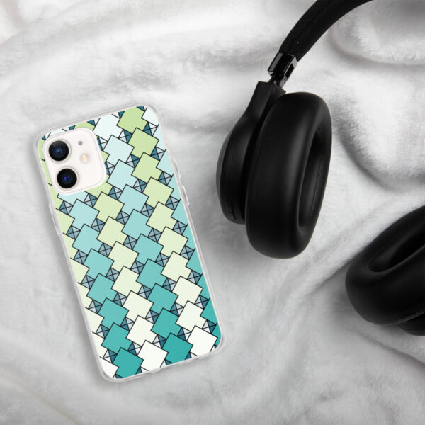 iphone case with a blue and green square tile pattern sitting next to headphones