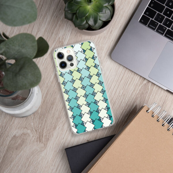 iphone case with a blue and green square tile pattern sitting on a desk next to a laptop