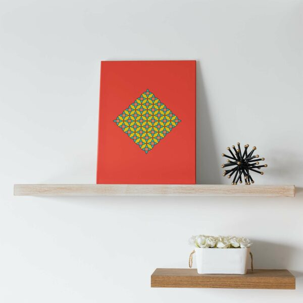 vertical stretched canvas art print with a colorful yellow mosaic design on a red background on a shelf