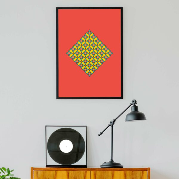 vertical fine art print with a colorful circle mosaic design on a red background in a black frame hanging on a wall