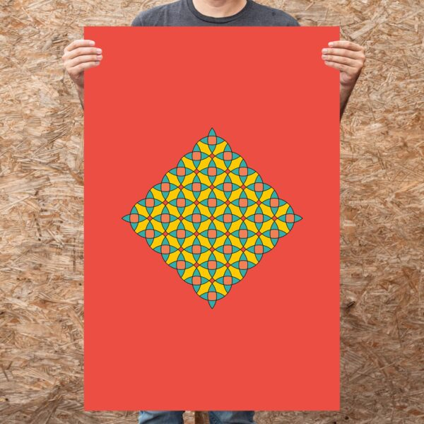 person holding a large vertical fine art print with a colorful circle mosaic design on a red background