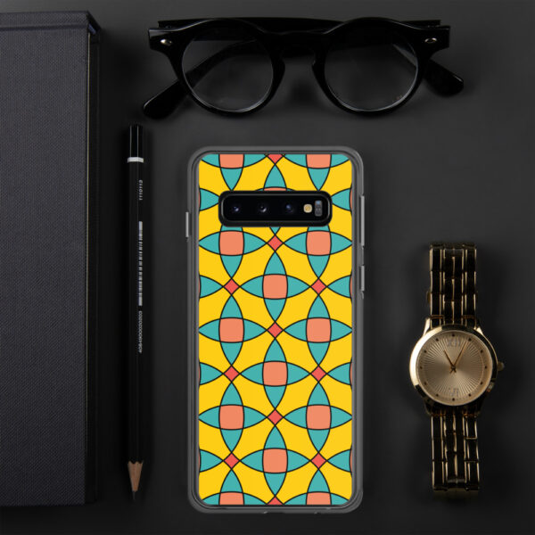 samsung phone case with a yellow orange and blue mosaic tile pattern sitting next to a watch