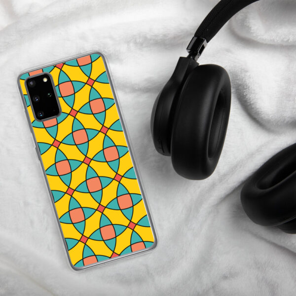 samsung phone case with a yellow orange and blue mosaic tile pattern sitting next to headphones