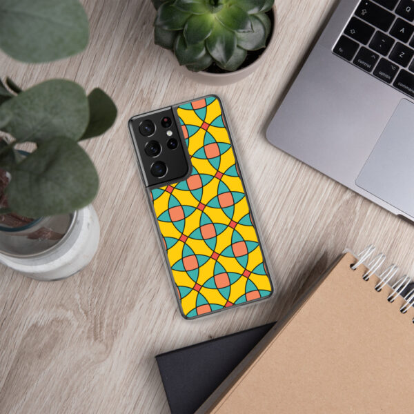 samsung phone case with a yellow orange and blue mosaic tile pattern sitting next to a laptop