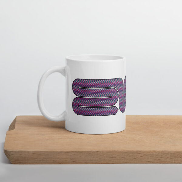 white ceramic coffee mug with a pink snake design wrapping around the side sitting on a cutting board