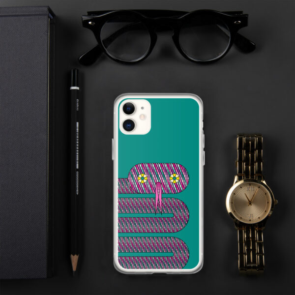 iphone case with a design of a pink snake on a teal blue background sitting next to a watch