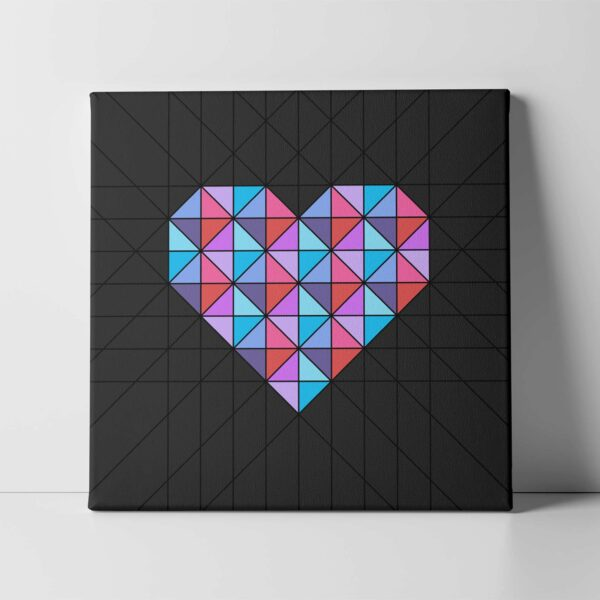 square stretched canvas art print of a pink and blue geometric heart design on a black background