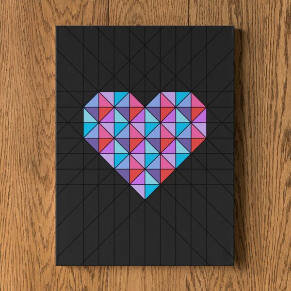 vertical stretched canvas art print of a pink and blue geometric heart design on a black background hanging on a wall