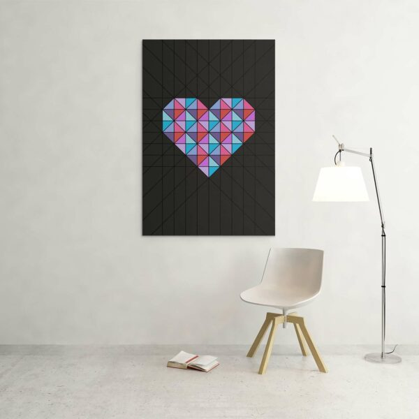 large vertical stretched canvas art print of a pink and blue geometric heart design on a black background hanging on a wall