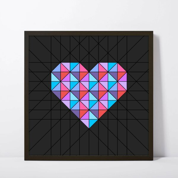 square fine art print of a pink and blue geometric heart design on a black background in a black frame