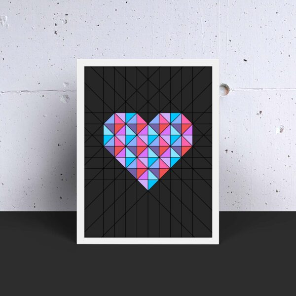 vertical fine art print of a pink and blue geometric heart design on a black background in a white frame
