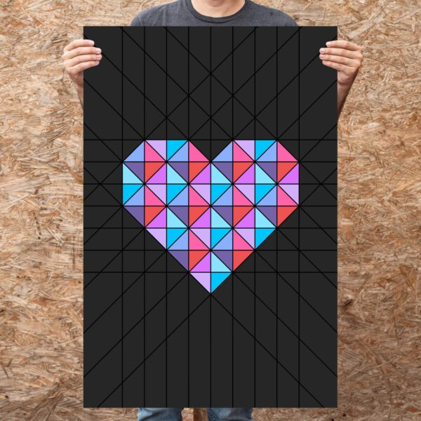person holding a large vertical fine art print of a pink and blue geometric heart design on a black background