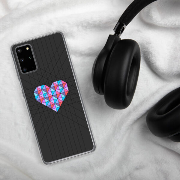 samsung phone case with a pink and blue geometric heard design on a black background sitting next to headphones