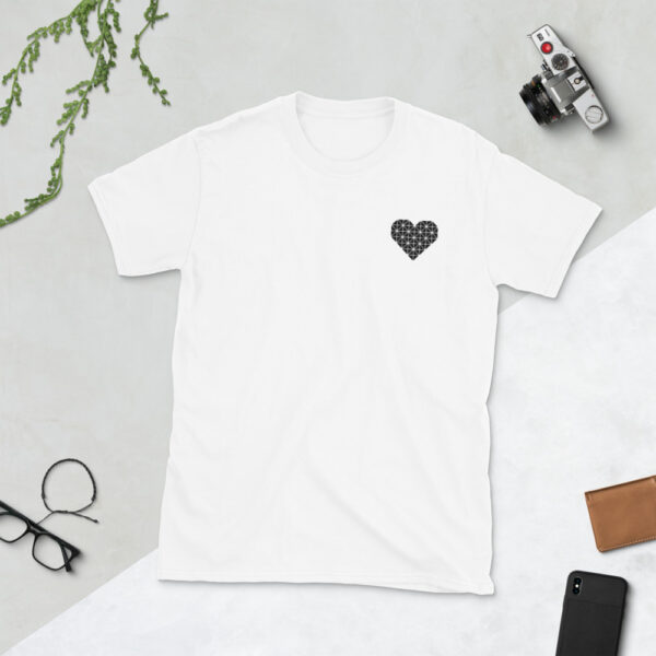 white t-shirt with a black geometric heart embroidered on the left chest next to a camera