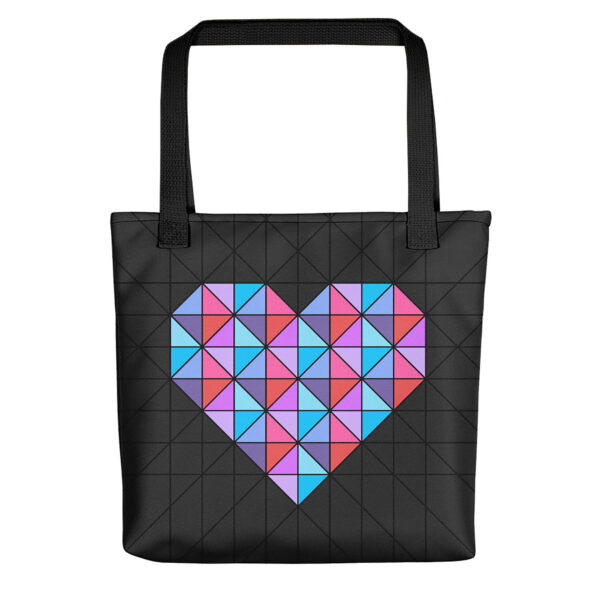 black tote bag with a geometric pink and blue heart design, with black handles