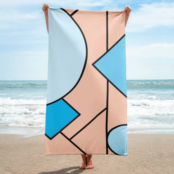 person on a beach holding a beach towel with an abstract design of blue and peach colored shapes