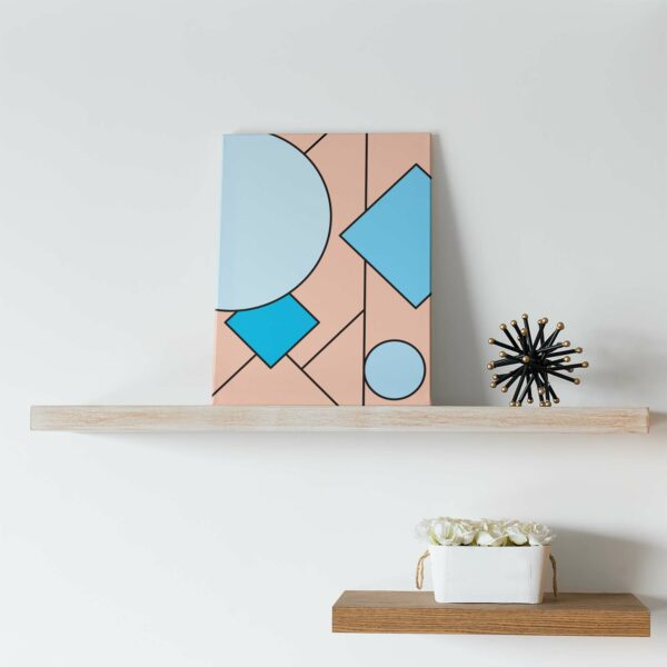 vertical stretched canvas print with an abstract blue and pink design on a shelf