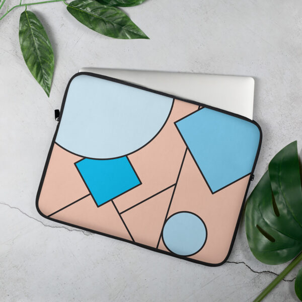 laptop sleeve with an abstract design of blue and pink shapes sitting on a table