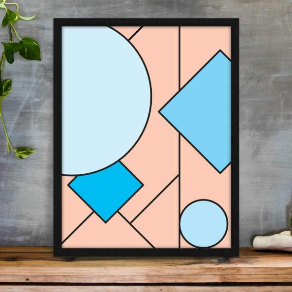 vertical fine art print with an abstract design of pink and blue shapes in a black frame on a table
