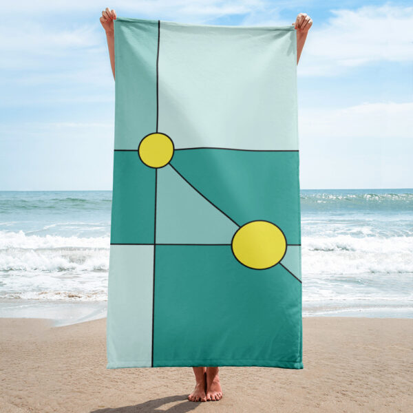 person on a beach holding a beach towel with blue shapes and two yellow circles in a minimalist design