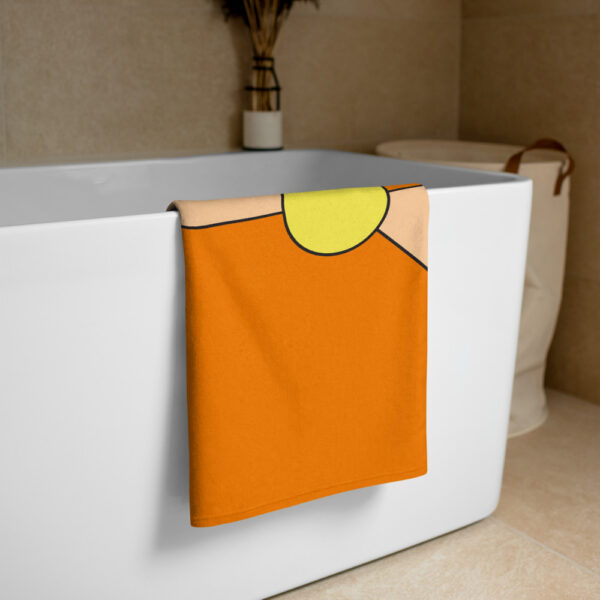orange and yellow towel draped over a bathtub