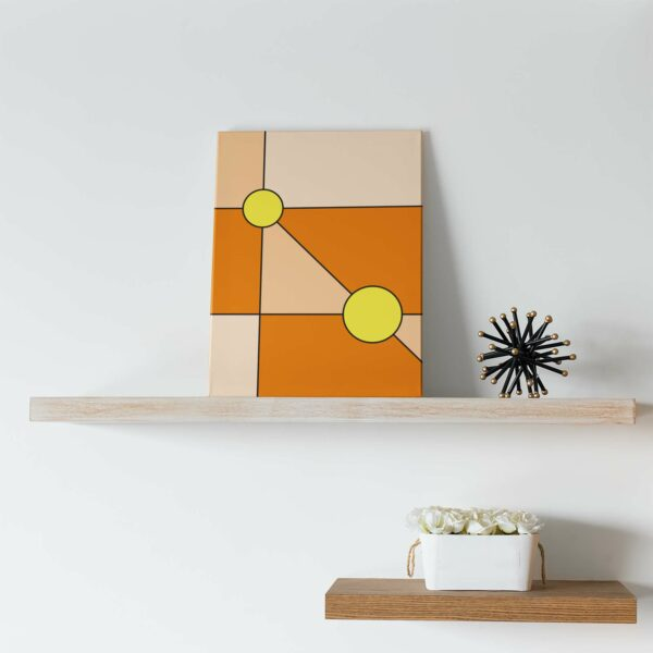 vertical stretched canvas print with a minimalist design of two yellow circles on an orange background on a shelf