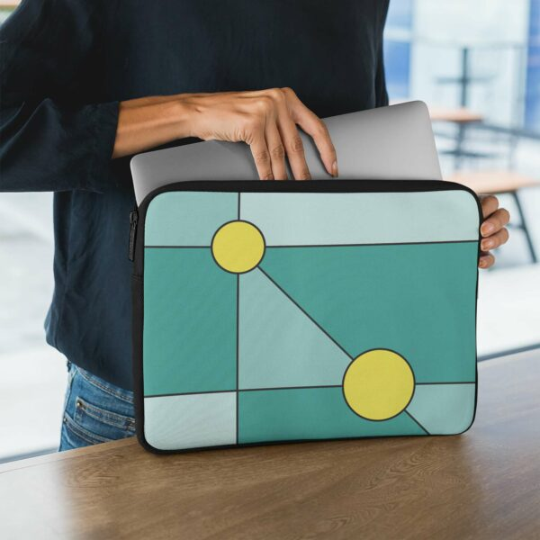 person holding a laptop sleeve with a minimalist design of two yellow circles on a teal blue background