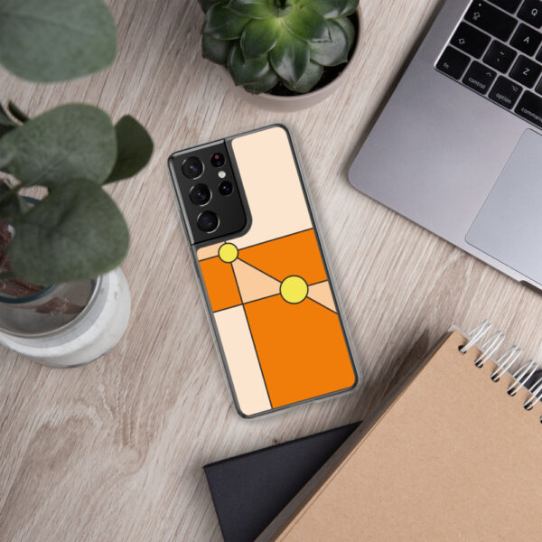 samsung phone case with a minimalist design of two yellow circles on an orange background sitting next to a laptop