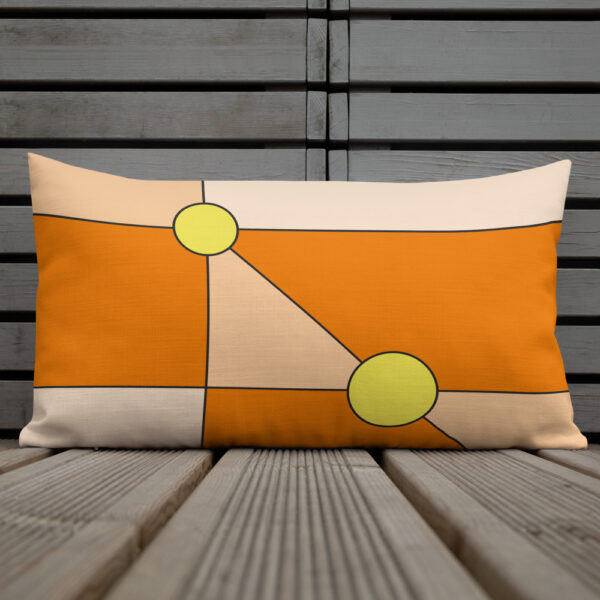 rectangle pillow with a minimalist design of two yellow circles on an orange background sitting on a deck